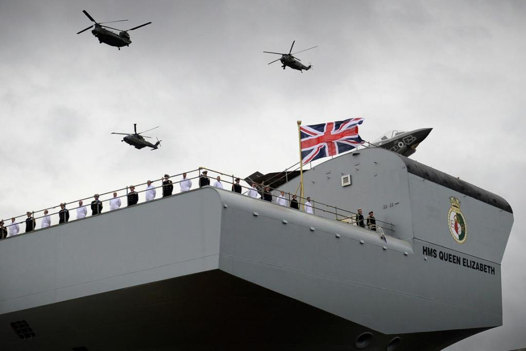 Helicopters fly over the Royal Navy warship HMS Queen Elizabeth during her naming ceremony at the Rosyth dockyard in Fife.