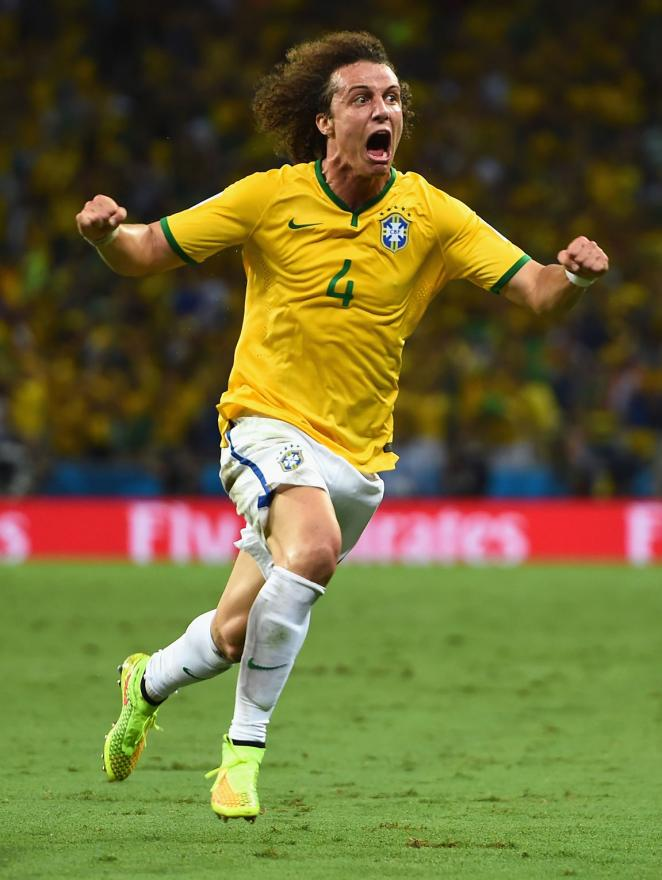 CELEBRATION: Brazil's David Luiz runs excitedly after scoring a stunning goal from a free-kick in the World Cup quarterfinals.