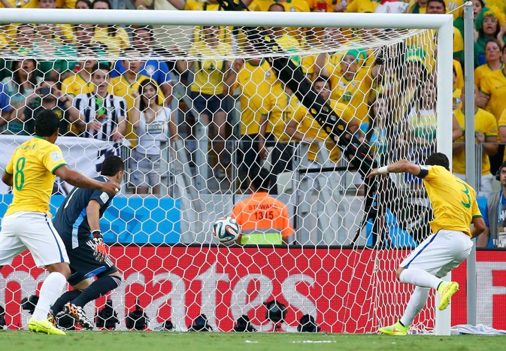 IT'S IN: Brazil captain Thiago Silva nudges in a loose ball from a Neymar corner to open the scoring in their quarterfinal against Colombia.