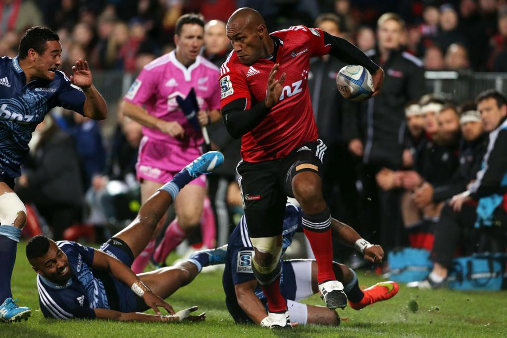 Crusaders wing Nemani Nadolo on the charge against the Blues at AMI Stadium in Christchurch.