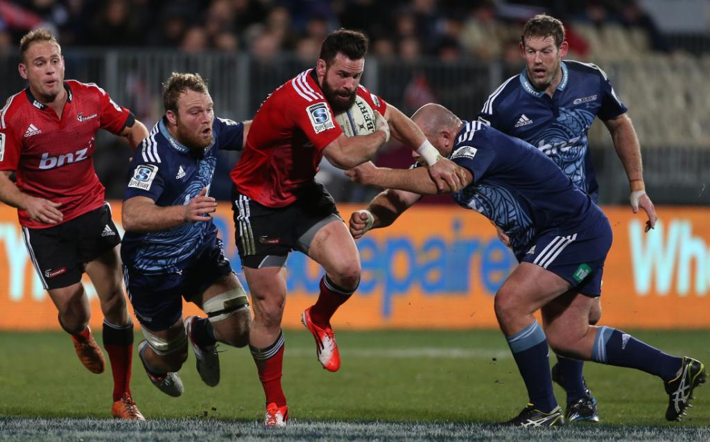 Crusaders centre Ryan Crotty has a cut at the Blues' line with Andy Ellis in support.