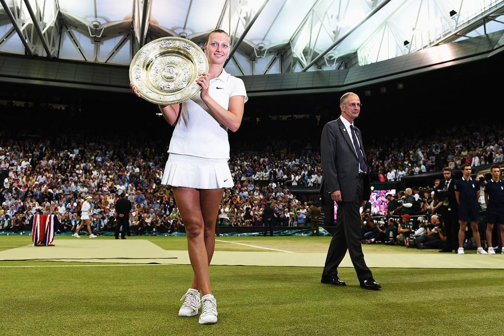 Petra Kvitova of the Czech Republic poses with the Venus Rosewater Dish trophy after her victory in the Ladies' Singles final against Canada's Eugenie Bouchard.