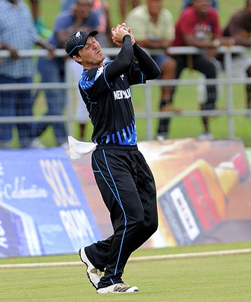TAKEN: NZ fieldsman BJ Watling holds a catch on the boundary to dismiss West Indies batsman Dwayne Smith during the first T20 International at Dominica.