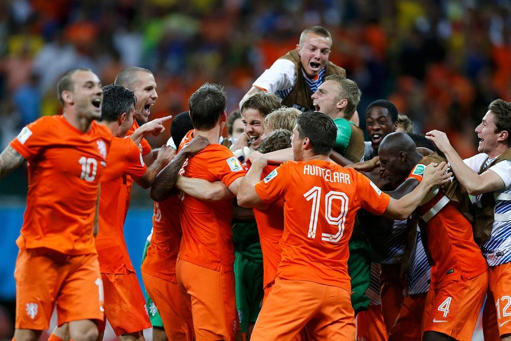 The Netherlands players celebrate after winning the penalty shootout in their quarterfinals against Costa Rica.