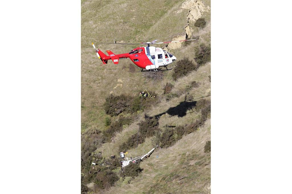 Two men have been flown to hospital after their helicopter crashed in a remote area near Blenheim.