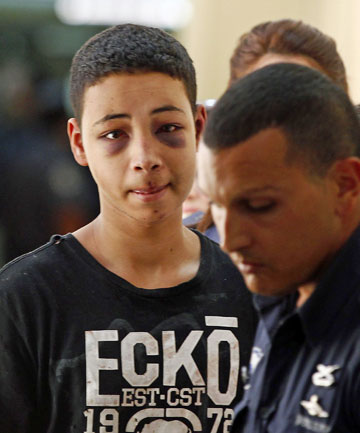 BEATING PROBED: Tariq Khdeir, the 15-year-old cousin of Mohammed Abu-Khdeir, believed to be killed by Jewish extremists, is escorted to court by Israeli prison guards.