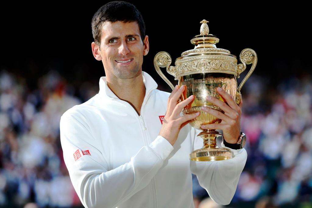 CHAMPION: Novak Djokovic celebrates winning his second Wimbledon crown.