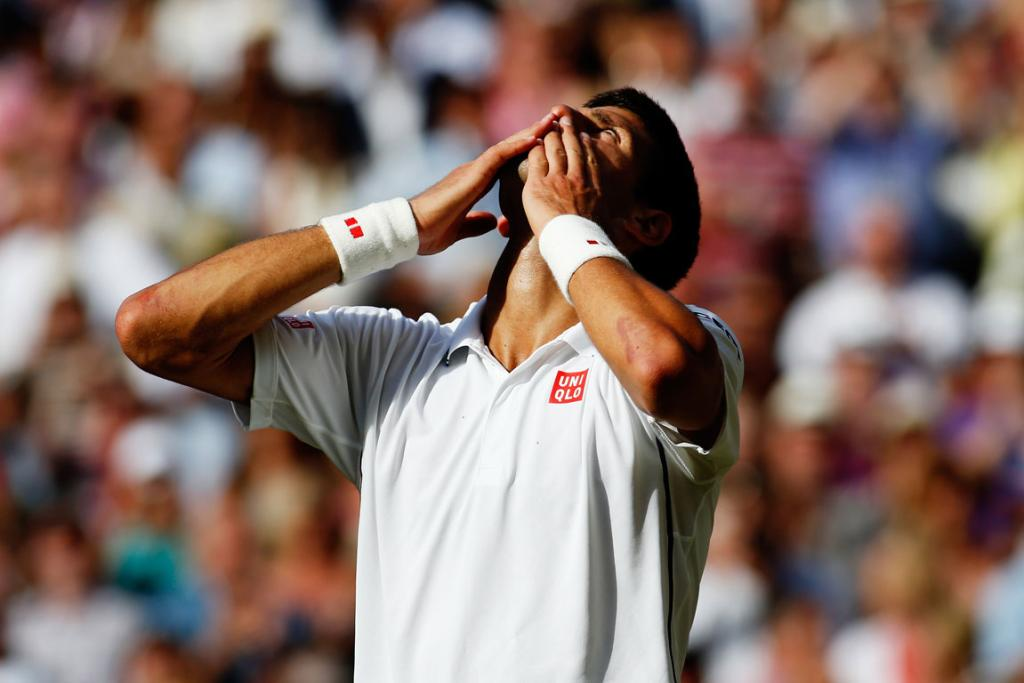 Novak Djokovic of Serbia blows kisses to the fans as he celebrates winning the Wimbledon title after beating Roger Federer of Switzerland in the final.