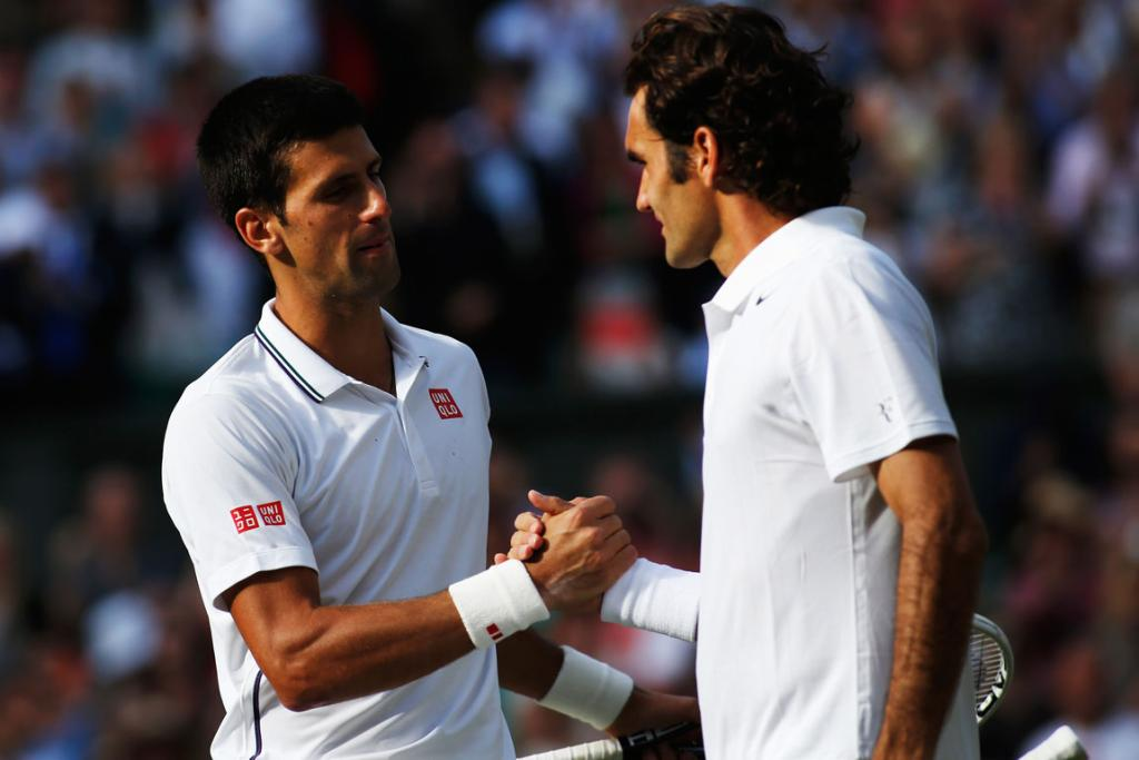 Novak Djokovic of Serbia shakes hands with Roger Federer of Switzerland after the men's singles final at Wimbledon.