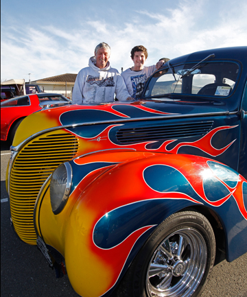 FIRED UP: Barry, left, and Ryan Hefford with their 1938 Ford Deluxe at the American Independence Day Cruise at the Nelson Suburban Club car park.
