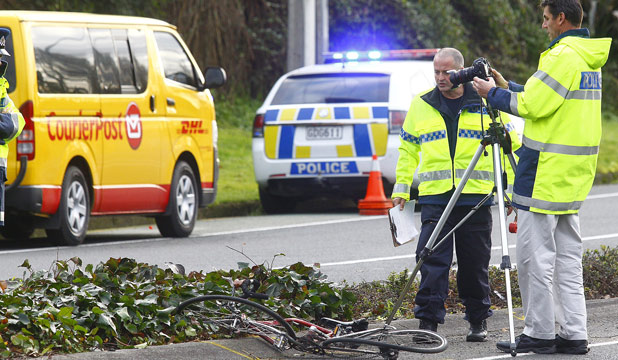 FATALITY: Police examine the scene of a fatal collision between a cyclist and a courier van at the corner of Morrinsville and Matangi roads at Hillcrest in Hamilton.