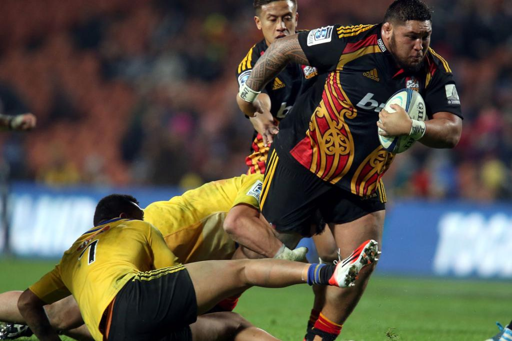 Ben Tameifuna of the Chiefs steps out of the tackles of Ardie Savea (left) and Jeffery Toomaga-Allen of the Hurricanes during his side's round 18 Super Rugby win in Hamilton.