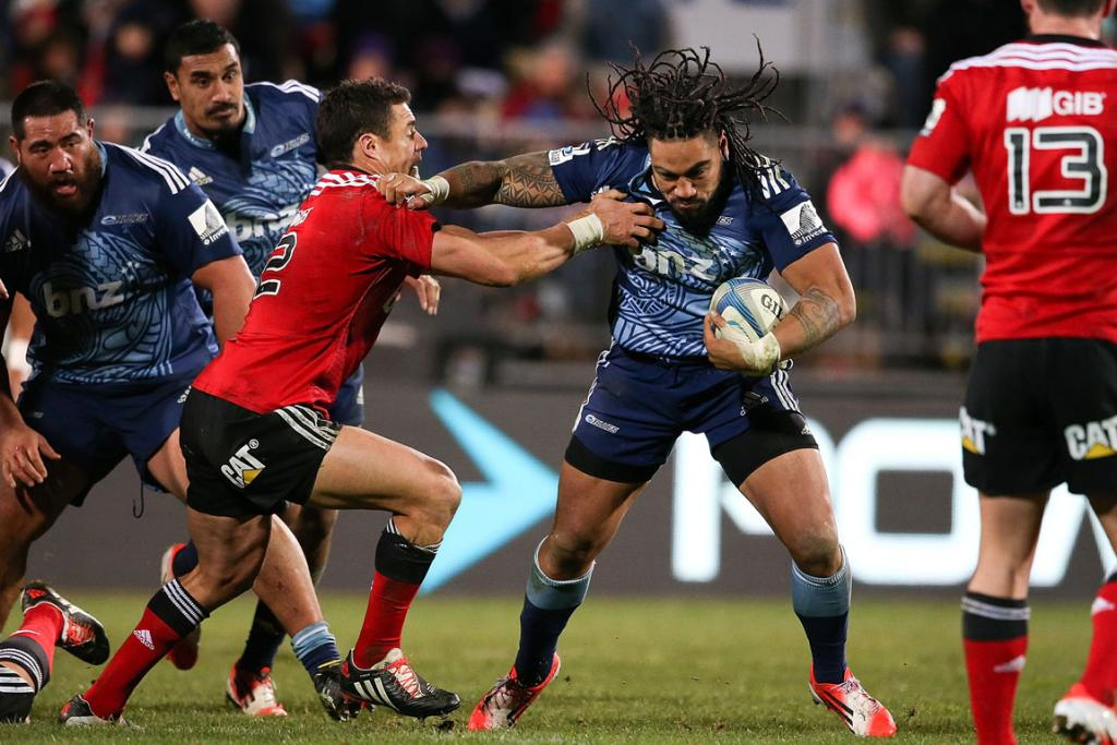 Blues star Ma'a Nonu is tackled by Dan Carter of the Crusaders during their round 18 Super Rugby match in Christchurch.