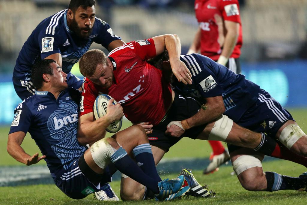 Crusaders lock Dominic Bird powers through a number of would-be Blues defenders at AMI Stadium in Christchurch.