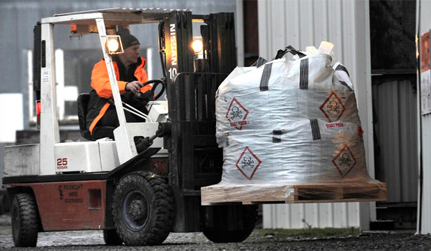 READY FOR PESTS: Bags of 1080 are unloaded and put into storage at the old Fiordland laundry sheds in the Te  Anau Industrial Estate.