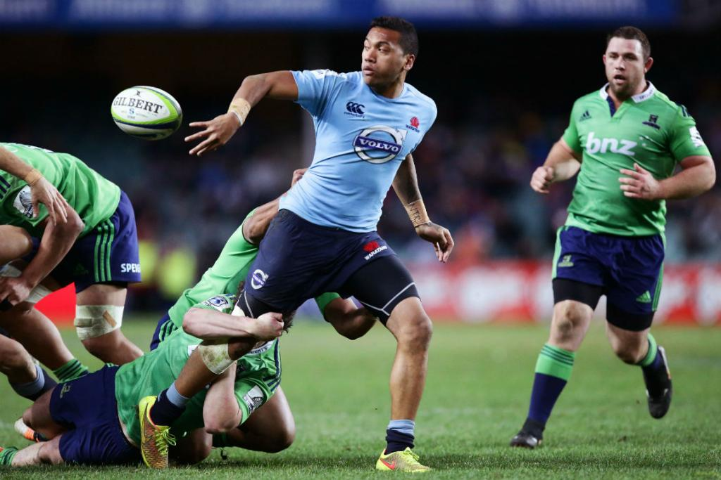 Waratahs winger Alofa Alofa offloads the ball in a tackle during his side's 44-16 win over the Highlanders.