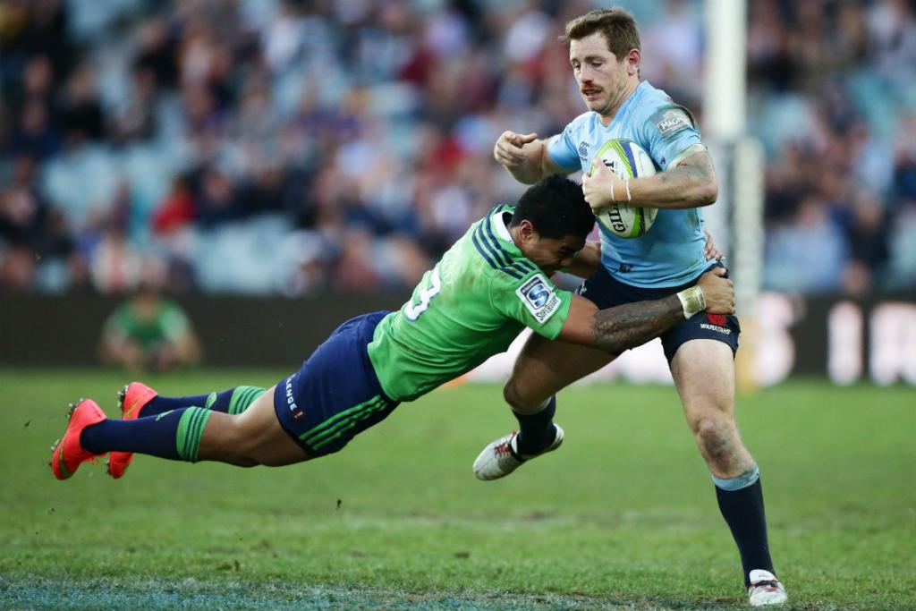 Waratahs  five-eighth Bernard Foley is tackled by Highlanders centre Malakai Fekitoa.