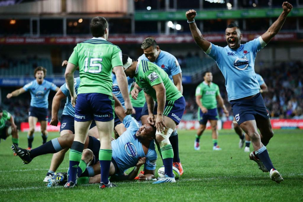 Waratahs prop Sekope Kepu celebrates scoring a try against the Highlanders.