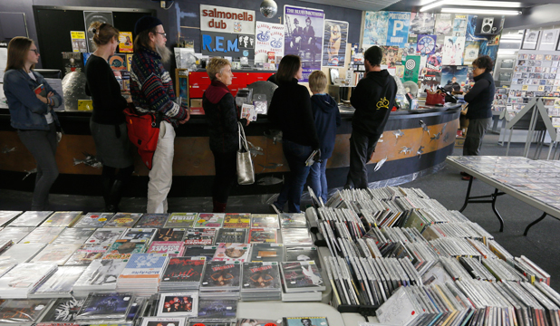 QUEUE THE MUSIC: People line up to grab a bargain at the Everyman Records liquidation sale in Hardy St.
