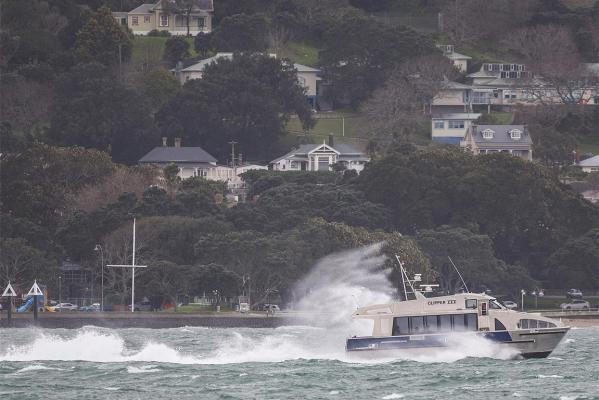 A boat battles its way up the Waitemata Harbour in the strong winds battering Auckland's East Coast.