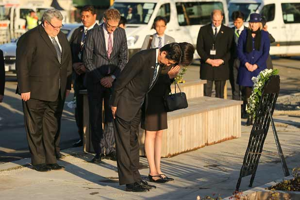 PAYING RESPECTS: Japanese Prime Minister Shinzo Abe and his wife Akie Abe lay a wreath at the CTV site on Monday.