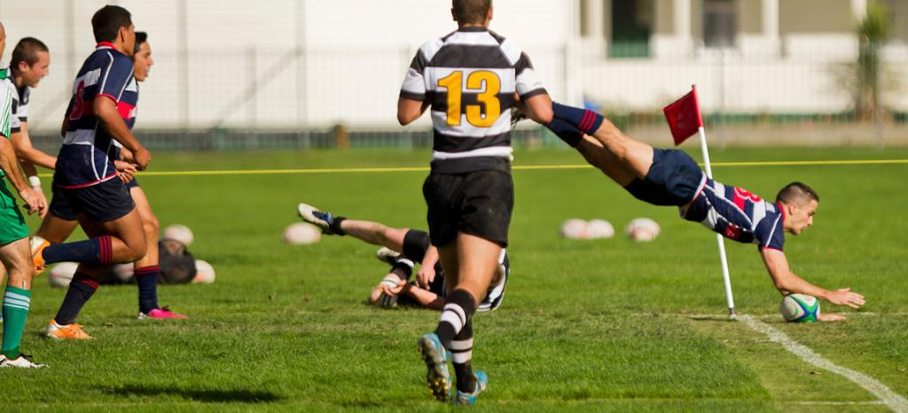 Feilding player Luther Hirini dives over the line to score a try during a Feilding High School vs New Plymouth Boys High rugby game.