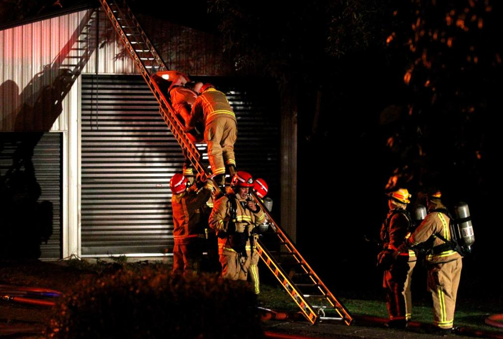 An elderly woman rescued by Emergency services at a house fire, New Plymouth.