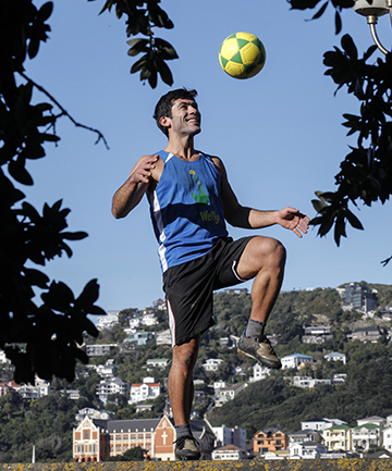 JUGGLING WORK AND PLAY: Brazilian Flavio Campos runs foot-volley classes at Frank Kitts Park in Wellington. He and his friends have managed to fit watching World Cup matches in around their work, he says.