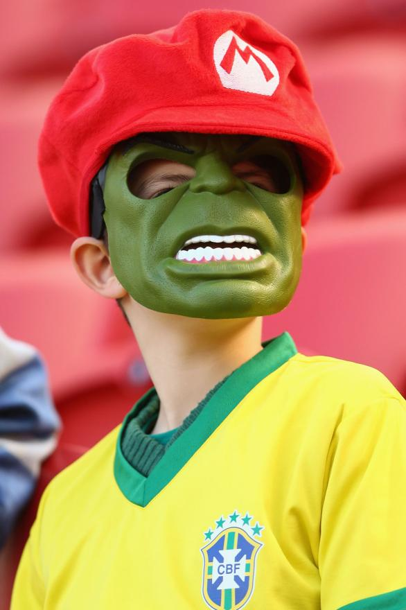A young football fan wears a Hulk mask in support of star Brazil player Hulk.