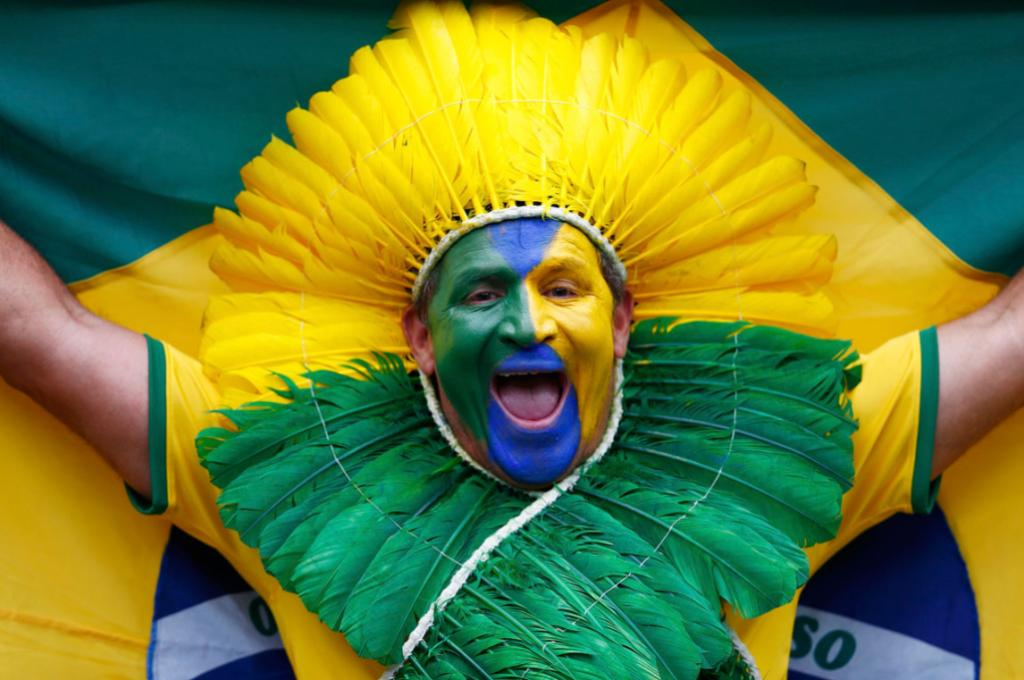 A football fan shows his colour at Mineirao stadium.