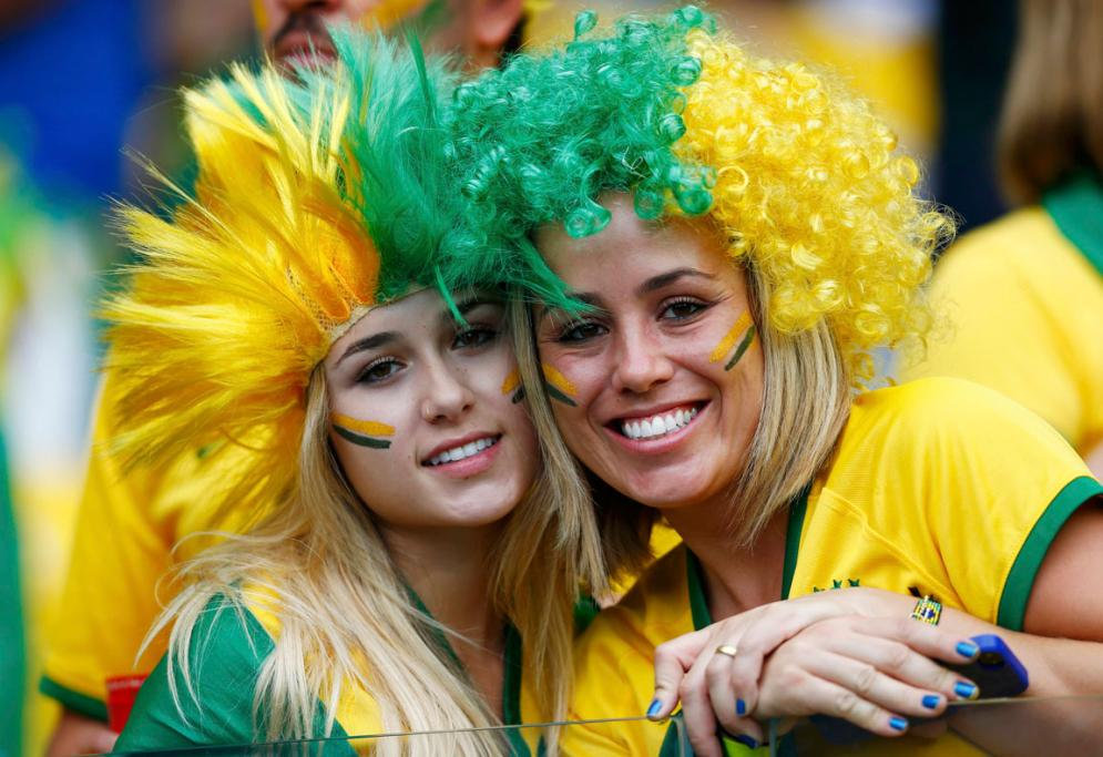 It's all green and yellow at Mineirao stadium as fans gather for the Brazil vs Germany football World Cup semifinal.