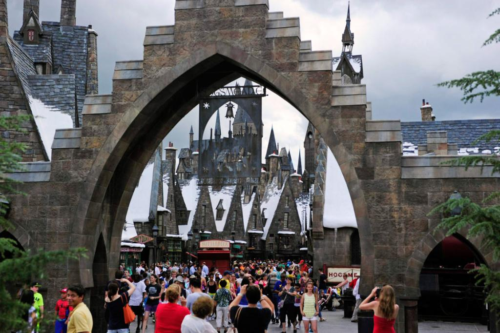 Guests walk in and out of Hogsmeade Village.