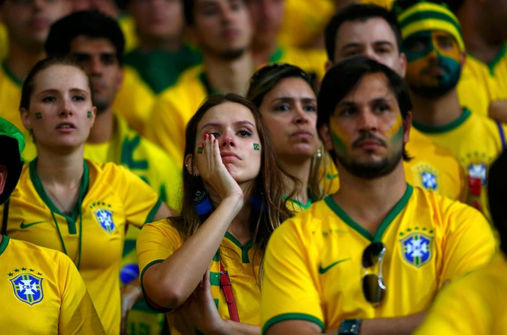STUNNED: Brazil fans can't believe their World Cup dream's nigh on over.