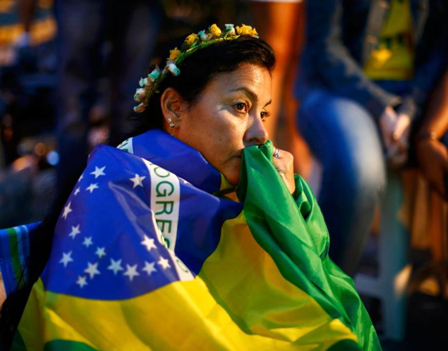 A NATION BROKEN: A Brazilian woman looks on in disbelief as Germany ruins the nation's World Cup dream.