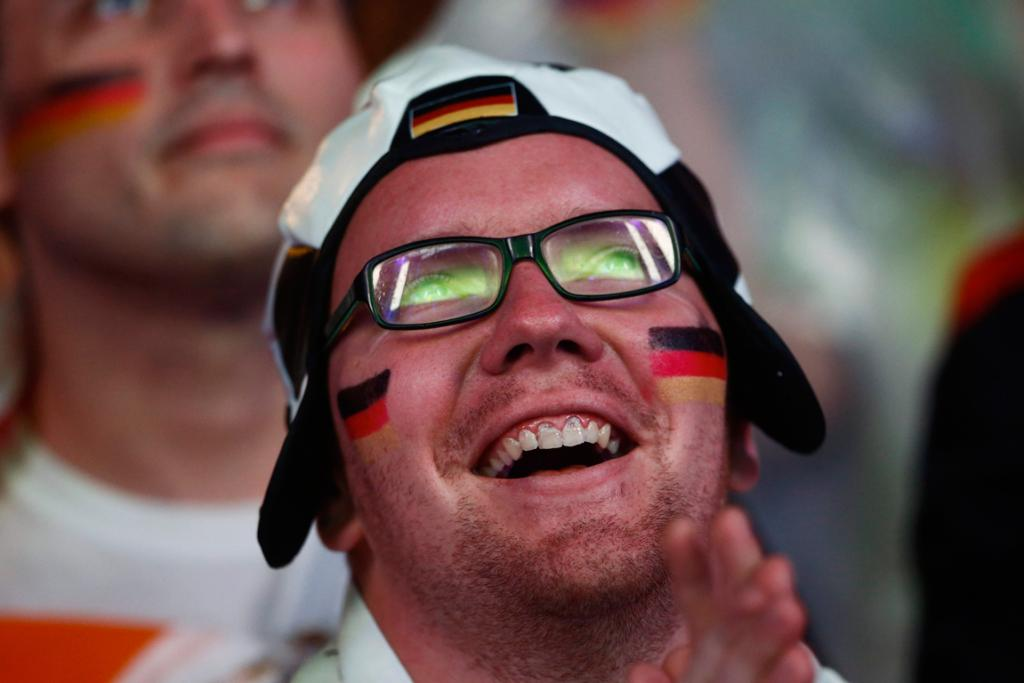 A German fan shows his delight as his side wipes the floor with Brazil.
