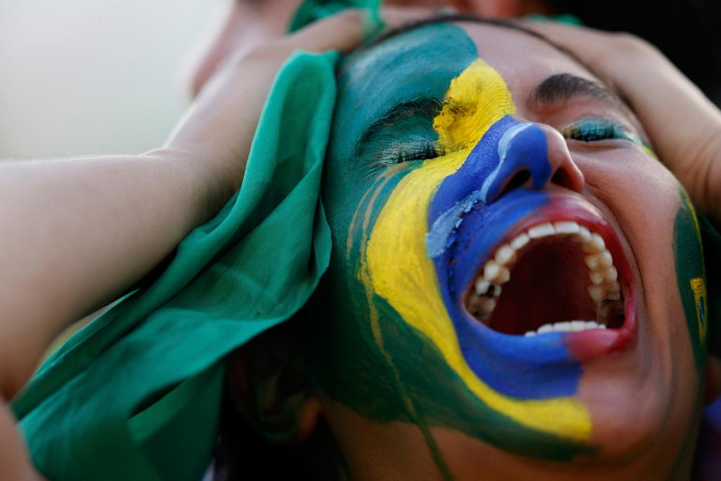 A distraught Brazil fan watches her side destroyed.