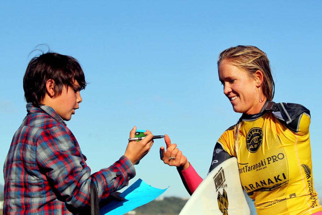 Hawaiian Bethany Hamilton signing autographs for fans at Port Taranaki Pro ASP Women's 6-Star qualifying series, NZ Surf Festival at Fitzroy Beach.