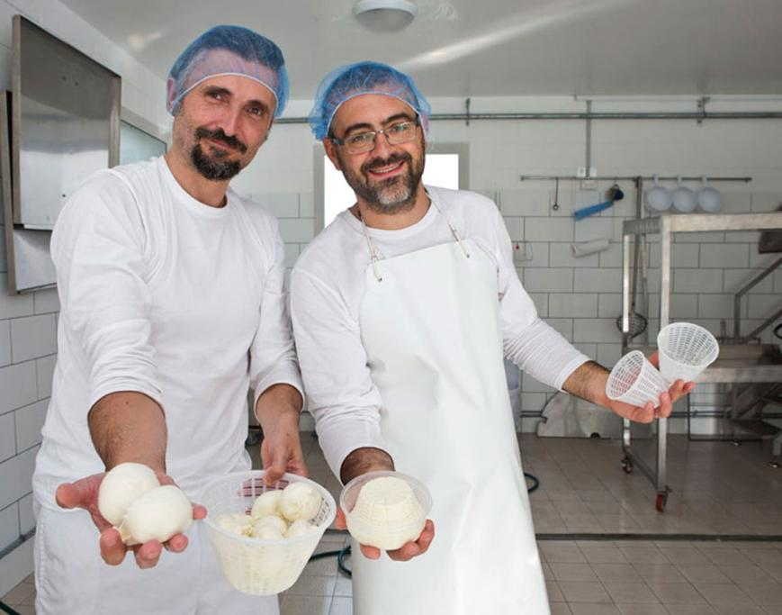 MilkDrop directors Matteo Bordini, left and Raffaello Sirri, with mozzarella and ricotta cheeses they have made.