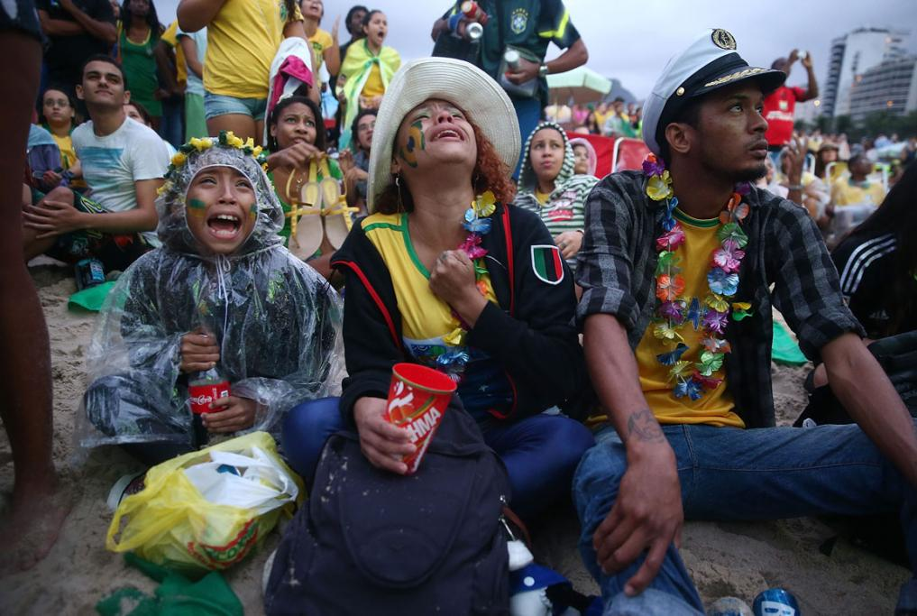 Brazil fans watching the semifinal against Germany on Copacabana Beach devastated by 7-1 loss.