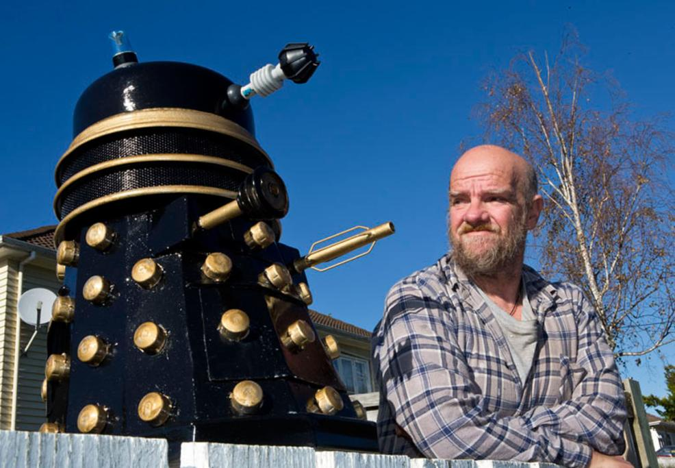 Kawai Street resident Bevan King with the Dalek letterbox he made from bits and pieces.