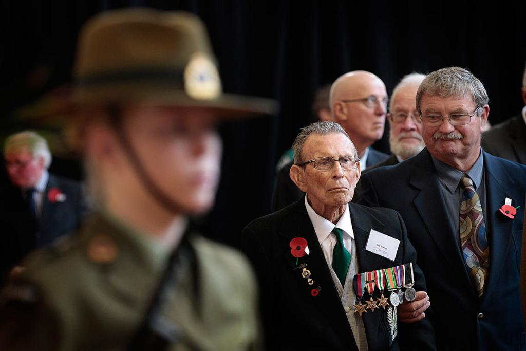 Veteran Bob Jeanes is supported by his youngest son Fread Jeanes during the 70th Anniversary of the battle of Monte Casino held at the Great Hall at Massey.