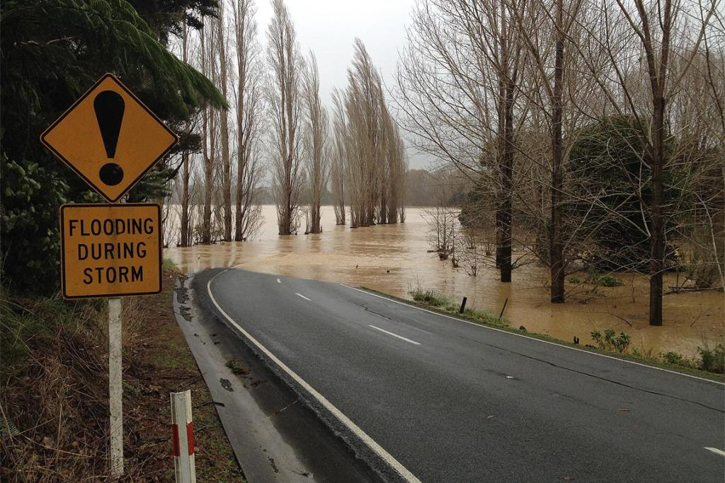 Two people had a lucky escape from a car stuck in flood water at Titoki, about 30 kilometres west of Whangarei, on Mangakahia Valley Rd.