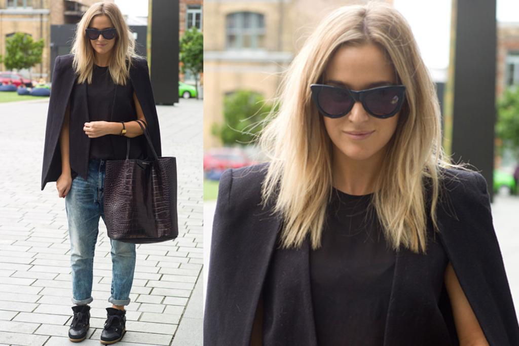 Chloe, spotted on the street in Britomart, looks super stylish in boyfriend jeans, a black cape and dark sunnies. We're loving her snakeskin tote - tres chic!