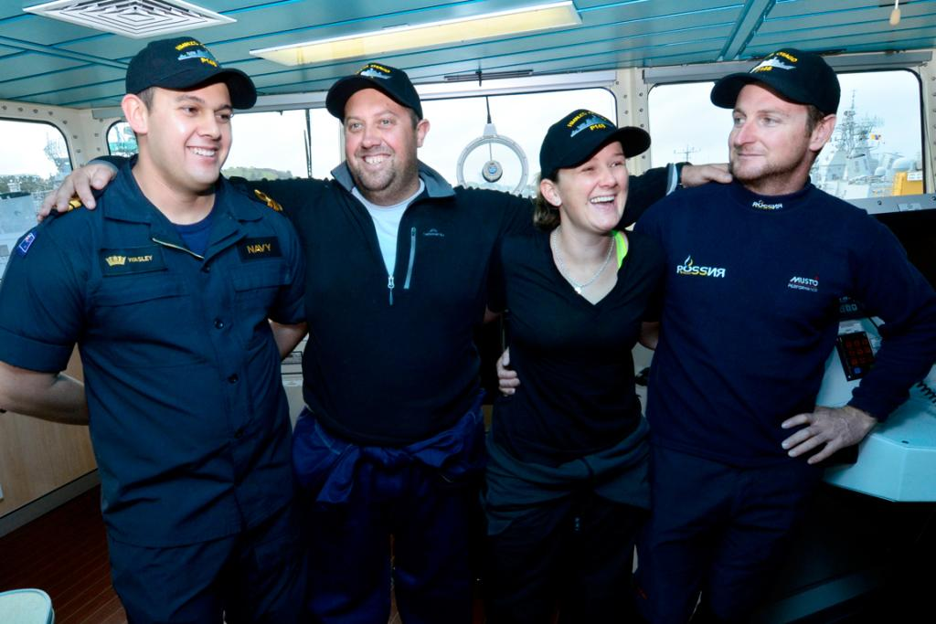 Lt Simon Wasley, left, of HMNZS Otago rescued Django11 sailors Andrew Cooke, Rebekka Hielkema and Ben Costello.