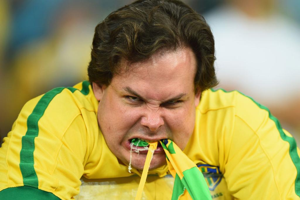 A football fan shows his fury at Brazil after their embarrassing 7-1 loss to Germany.