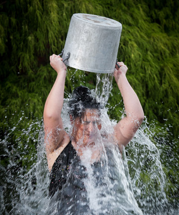 Donnalee Biddle tips ice water over her head.