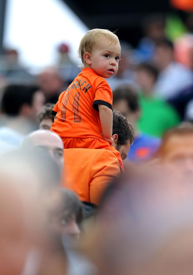 A young boy is carried into Corinthians to watch the semifinal.