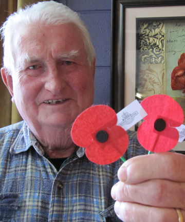 HOME AGAIN: Waimate Returned and Services Association president Ron Bailey is pleased to see Anzac poppy production return to New Zealand.