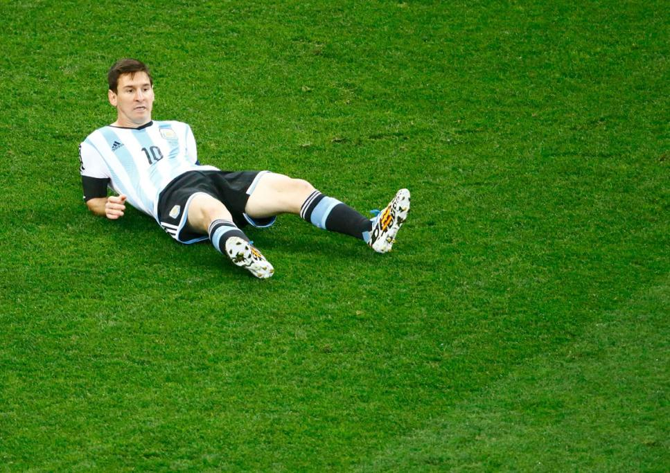 Lionel Messi lies on the ground after an early challenge in the semifinal.