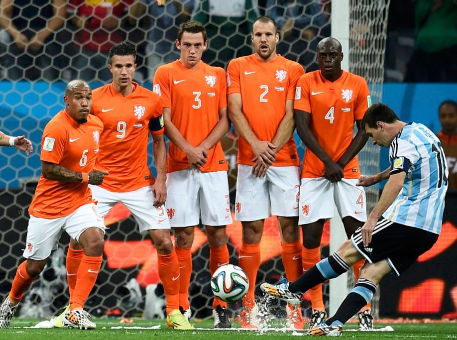 Argentina star Lionel Messi takes a shot from a free kick.